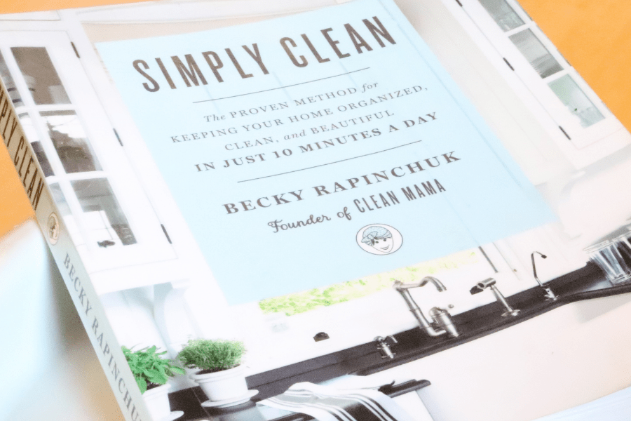 Cover of the Simply Clean book against a wood background
