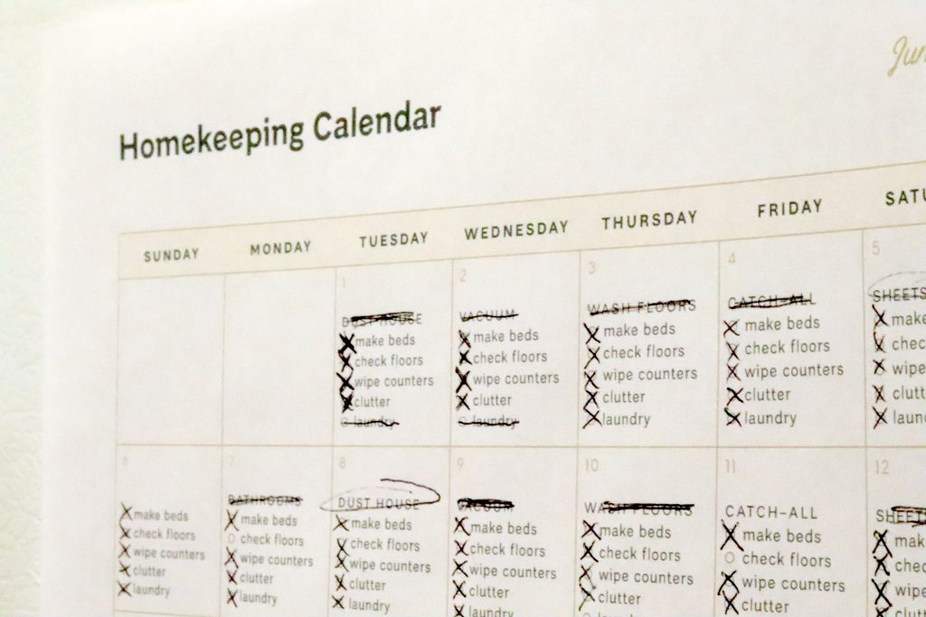A checklist that says Homekeeping Calendar with tasks to do each day of the week