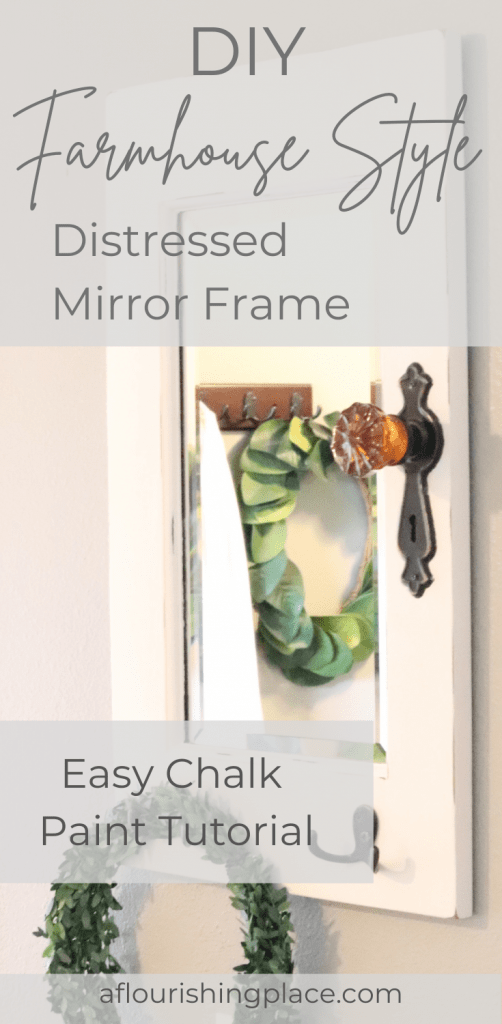 white framed mirror with an old fashioned doorknob on a grey wall