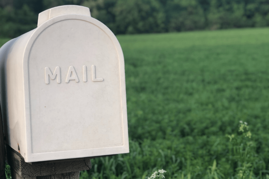 a white mailbox against a green grass backdrop