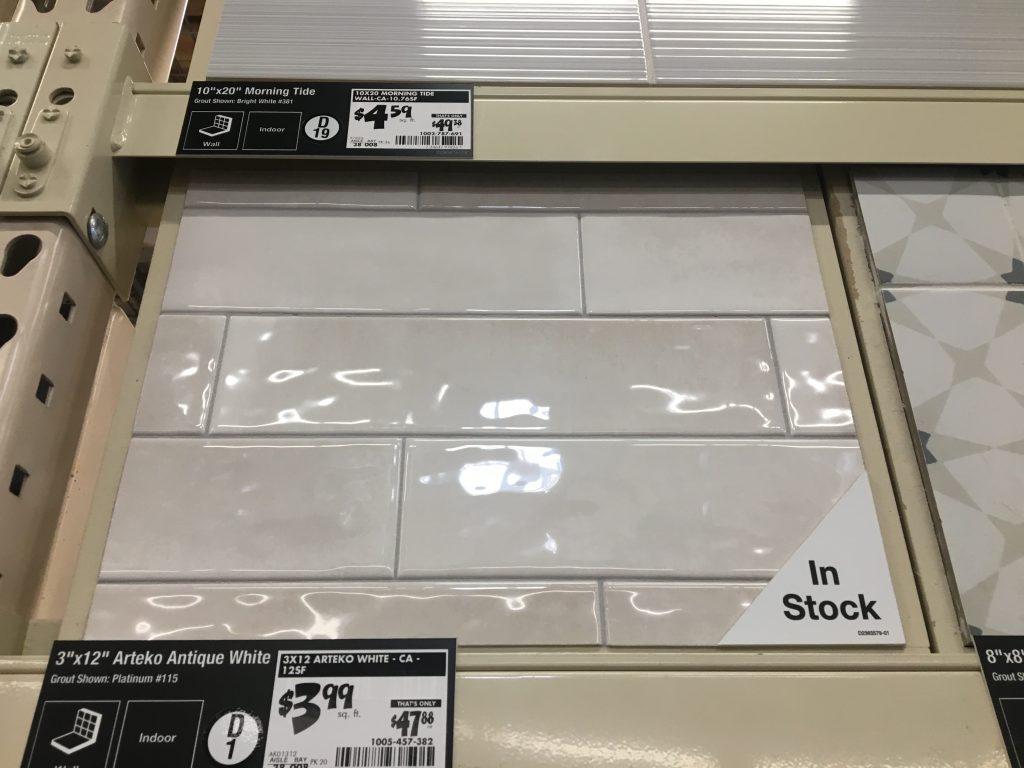 A large sqaure sample of off-white subway tile with the price listed beneath