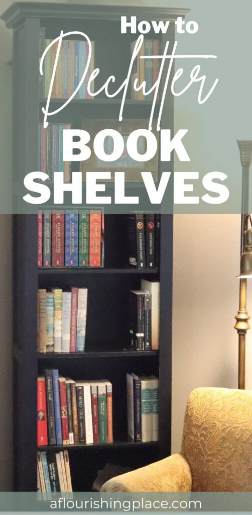 Narrow black bookcase with sets of books grouped on the shelves, a copper chair sits in front with a brass reading floor lamp behind it